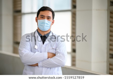 Portrait male doctor wearing a white glue, preparing to check the patient #1559527859