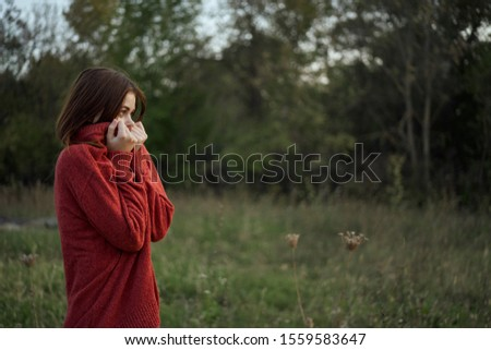young woman in a red warm sweater on the street #1559583647