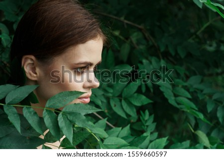 woman model outdoors with green foliage #1559660597