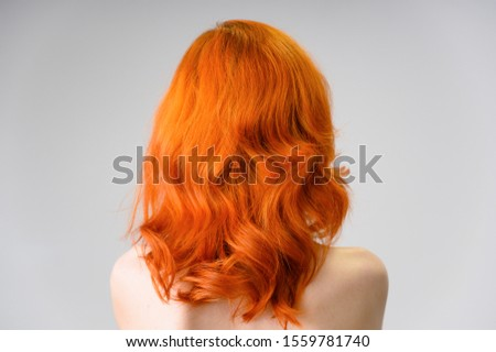 Close-up portrait of a red-haired pretty girl with excellent makeup and bright curly hair on a white background. Beauty concept, sample of beautiful hairstyle and makeup with cosmetics. #1559781740