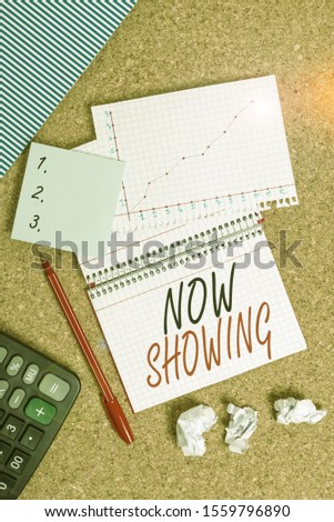 Conceptual hand writing showing Now Showing. Business photo text opportunity for the public to see something currently available Desk notebook paper office paperboard study supplies chart. #1559796890