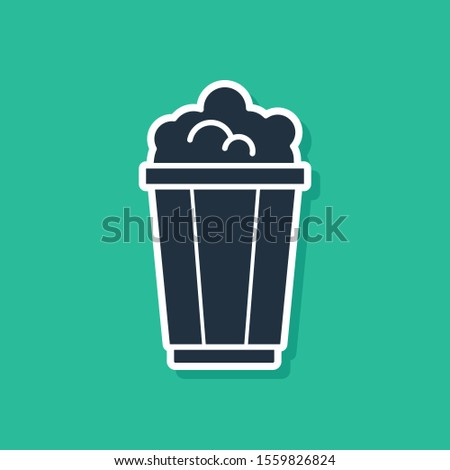 Blue Popcorn in cardboard box icon isolated on green background. Popcorn bucket box.  Vector Illustration #1559826824