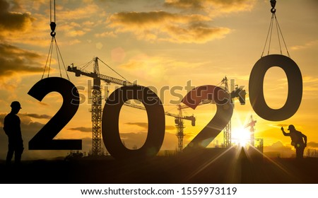 Silhouette construction site,Cranes building construction 2020 year sign #1559973119