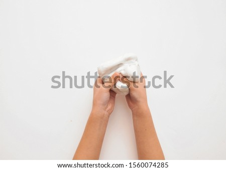Child hands with slime on background. #1560074285