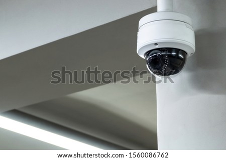 A review of surveillance cameras on white background. Security concept. Facial recognition. Program search for criminals. Royalty-Free Stock Photo #1560086762