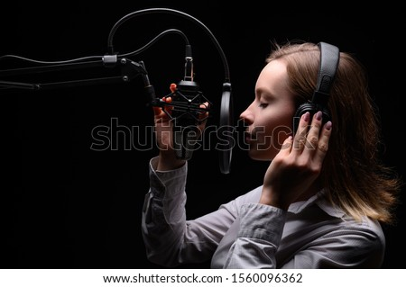 Singer, blogger, voice acting. Work in the studio with a studio microphone. #1560096362