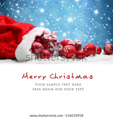 Santa Claus red bag with Christmas balls and gift box on snow. Royalty-Free Stock Photo #156010958