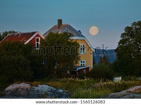 Full Moon over House in rural Norway #1560126083