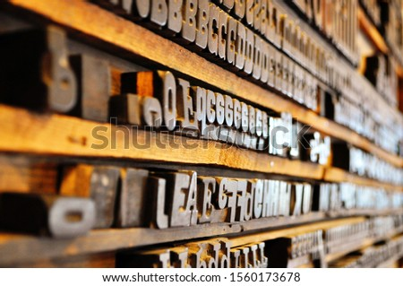 Set of vintage old print wooden letters in typography. Lettering, typography, graphic design concept. Single letters. Abstract background for your ideas. #1560173678