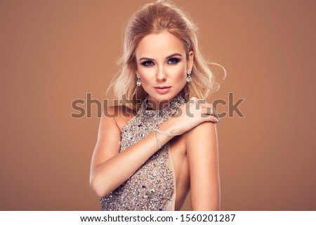 Beautiful young blonde woman in sexy glitter costume. Party carnival glamour photo #1560201287