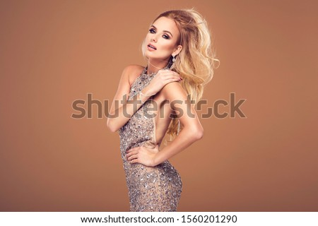 Beautiful young blonde woman in sexy glitter costume. Party carnival glamour photo #1560201290