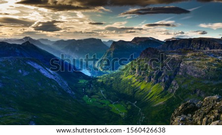 Tourism vacation and travel. Fantastic view on Geirangerfjord and mountains landscape from Dalsnibba viewpoint, evening time, Norway. #1560426638