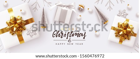 Holiday banner Merry Christmas and Happy New Year. Xmas design white gifts boxes, silver volume snowflake, glass ball. Christmas tree. flat lay, top view. Horizontal festive poster, header for website #1560476972