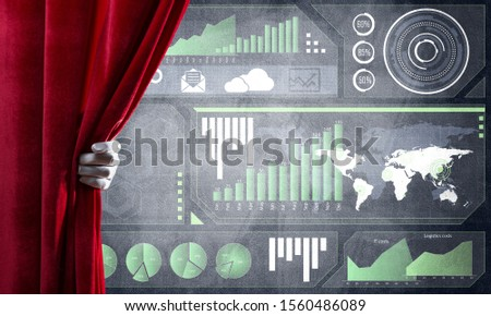 Hand opening red curtain and drawing business graphs and diagrams behind it #1560486089