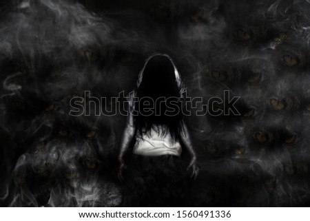 Ghost with cat eyes and smoke on dark night background,Halloween concept #1560491336