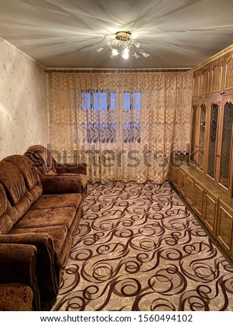 brown sofa with armchairs and carpet #1560494102