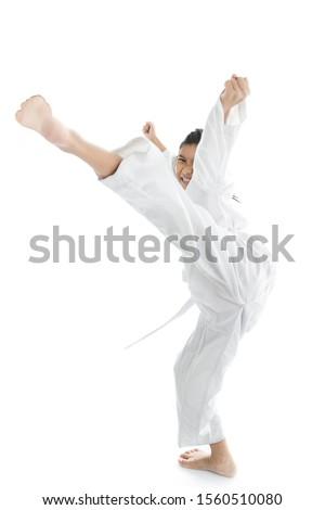 Asian taekwondo girl on with background. #1560510080