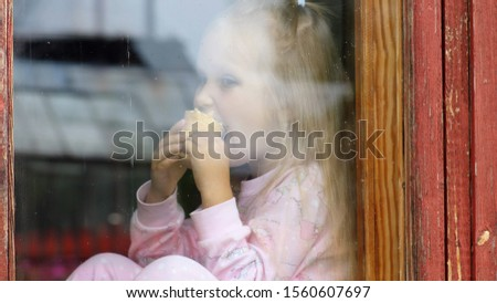 Little girl with a sad look. Children's sadness and depression #1560607697
