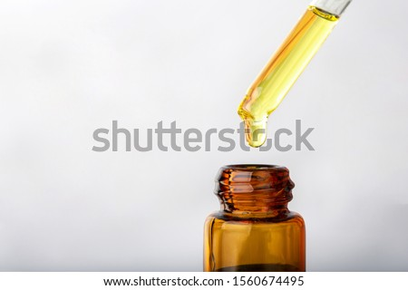 close up dropper with Cannabis CBD Oil used for medical purposes.marijuana CBD oil #1560674495