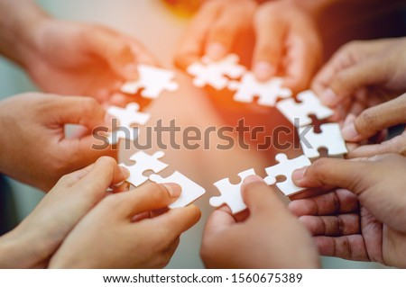 Team work, hands and jig Saw Unite with power Is a good team of successful people Team work concept #1560675389