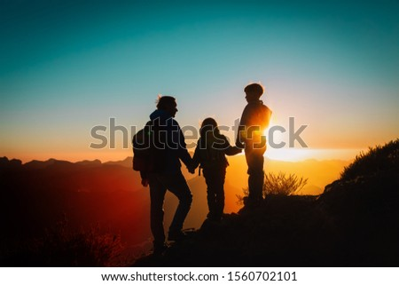 Father with kids-boy and girl- travel in sunset mountains #1560702101
