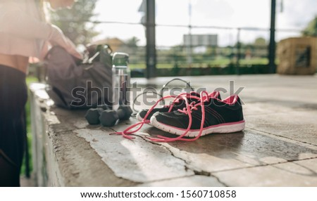 Girl taking sports equipment out of sports bag preparing for her training #1560710858