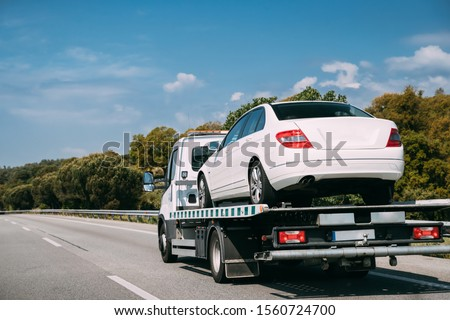 Car Service Transportation Concept. Tow Truck Transporting Car On Motorway Freeway Highway. Help On Road Transports Wrecker Broken Car. Transportation Faults And Emergency Cars. #1560724700