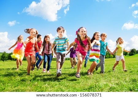 Many different kids, boys and girls running in the park on sunny summer day in casual clothes #156078371
