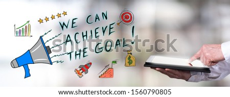 Man using a tablet with goal achievement concept #1560790805