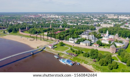 Veliky Novgorod, Russia. Novgorod Kremlin (Detinets), Volkhov River. Flight over the city, From Drone   #1560842684