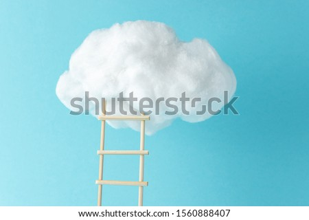 Stepladder leading to the clouds. Success and progress concept. Minimal composition. #1560888407