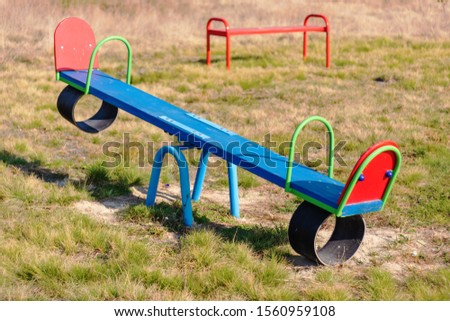 Playground in the countryside, with different types of swings and swings for children. #1560959108