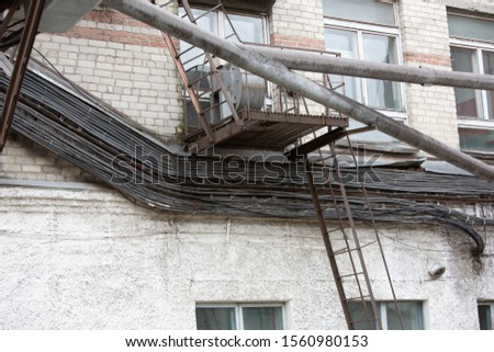 coils of wire, wires on the roof of the building  #1560980153