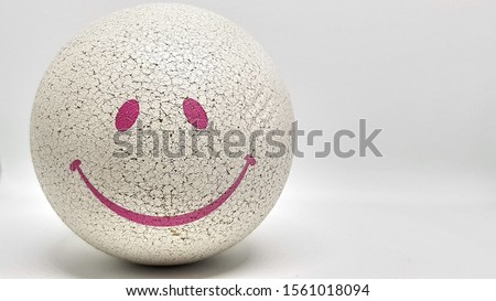 ball with a smile face Royalty-Free Stock Photo #1561018094