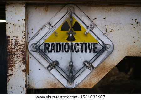 Old radioactive sign taken at the back of a semi trailer.