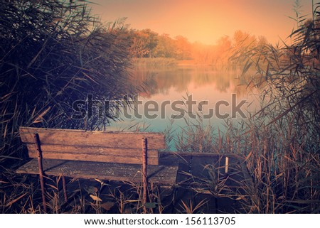 Vintage photo of bench at the lake