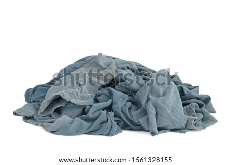 Old dirty ragged cloth with shadow isolated on a white background. Blue gray fabric with brown spots. Crumpled torn rag. Copy space #1561328155