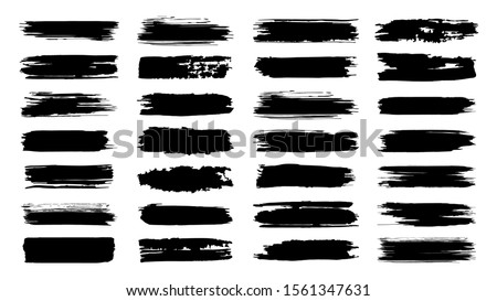 Brush paint strokes. Texture brushes and modern grunge brush lines. Ink brush artistic design element for frame design. Vector isolated elements set. Grungy black swatches. Rough smears and stains #1561347631
