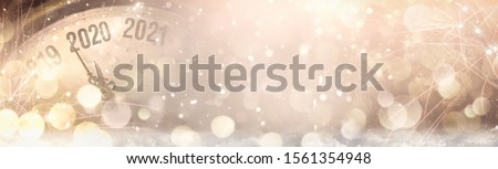 Retro style clock counting last moments before Christmass or New Year 2020. Royalty-Free Stock Photo #1561354948