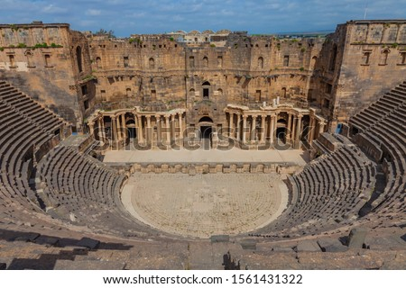 Theater at the Ancient City of Bosra, UNESCO World Heritage. and ruins of roman city Bosra in Syria Royalty-Free Stock Photo #1561431322