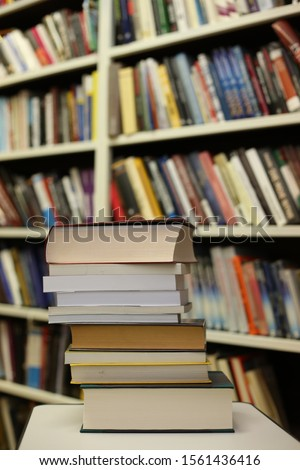 Stack of books in library #1561436416