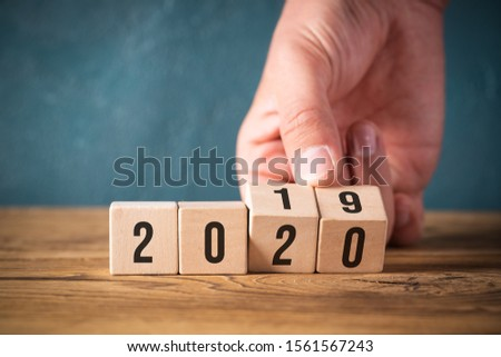 hand flipping two cubes with year 2019 to 2020 #1561567243