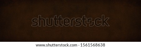 Wide dark bronze colored shabby cement plaster texture. Rough surface widescreen backdrop. Large grunge background #1561568638