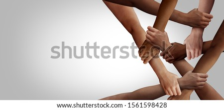 Business diversity and teamwork as a group of diverse people holding arms as a multiracial society and multicultural community joined and united team building as a together and togetherness concept. Royalty-Free Stock Photo #1561598428