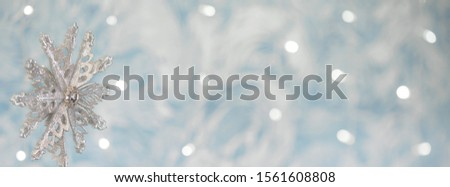 silver snowflake on blue xmas background with space for your text. Merry christmas. #1561608808