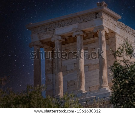 Athena Nike ancient Greek temple on Acropolis hill night view under starry sky, Athens Greece #1561630312