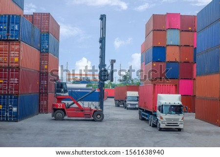 Container handlers work in cargo ports, cargo stations #1561638940