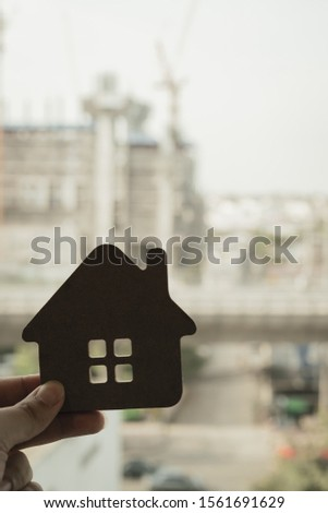 House model in home insurance broker agent 's hand or in salesman person. Real estate agent offer house, property insurance and security, affordable housing concepts #1561691629