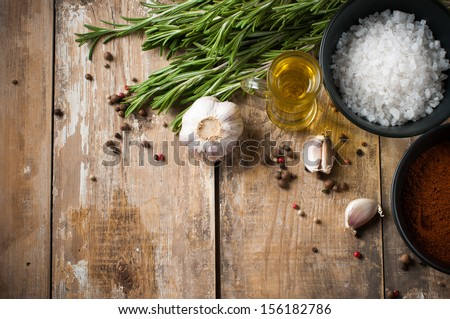 Different spices, rosemary, allspice, garlic, oil and salt on a wooden board, rustic kitchen background #156182786