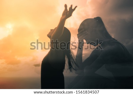 Sad woman becomes happy and free. People letting go of fears, sadness, grief and pain concept. Royalty-Free Stock Photo #1561834507